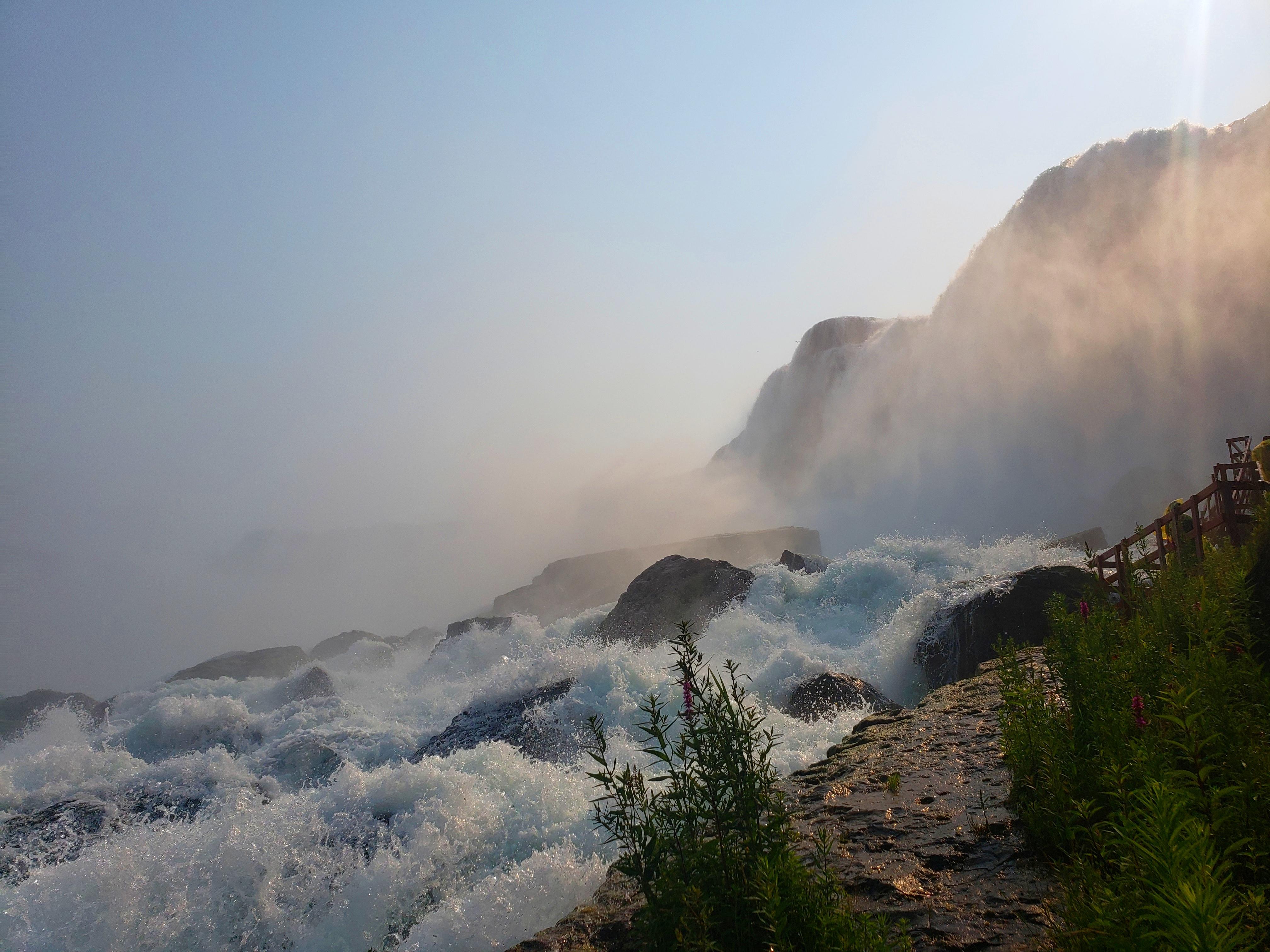 Water cascading over rocks as it falls in Niagara Falls.