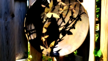 The Orton effect used on a photo of a decorative medallion covered in butterfly's to look dreamy.